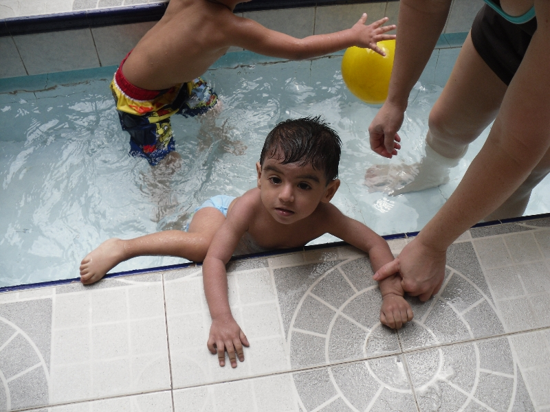 Boy Getting out of the Pool