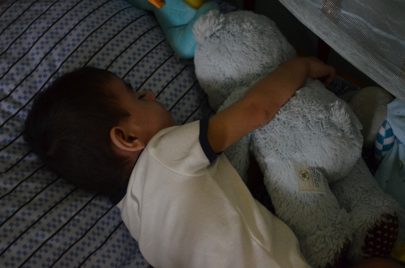 Cooper Sleeping with His Bear